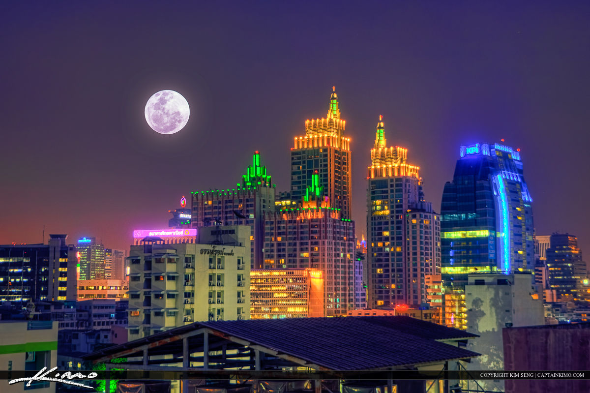 Full Moon Rise Over Roof Top in Bangkok Thailand