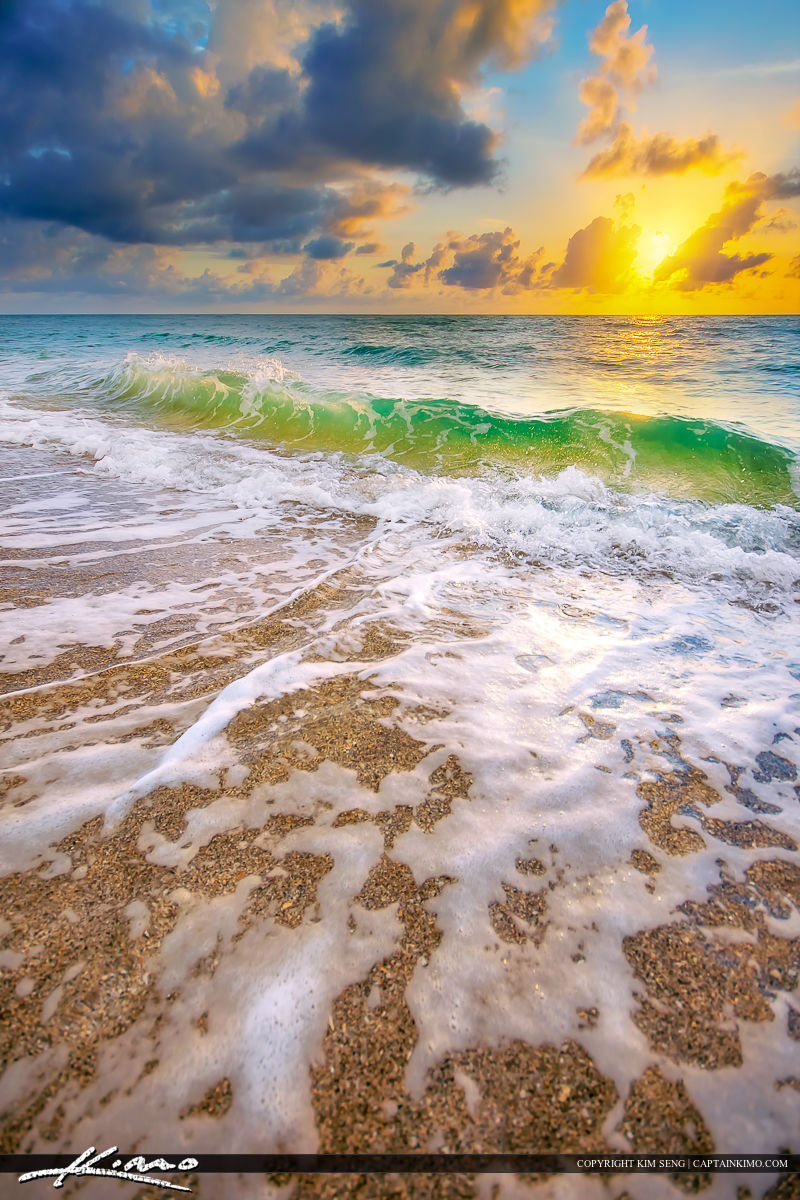 Awesome colors at the beach during sunrise at Singer Island, Florida.