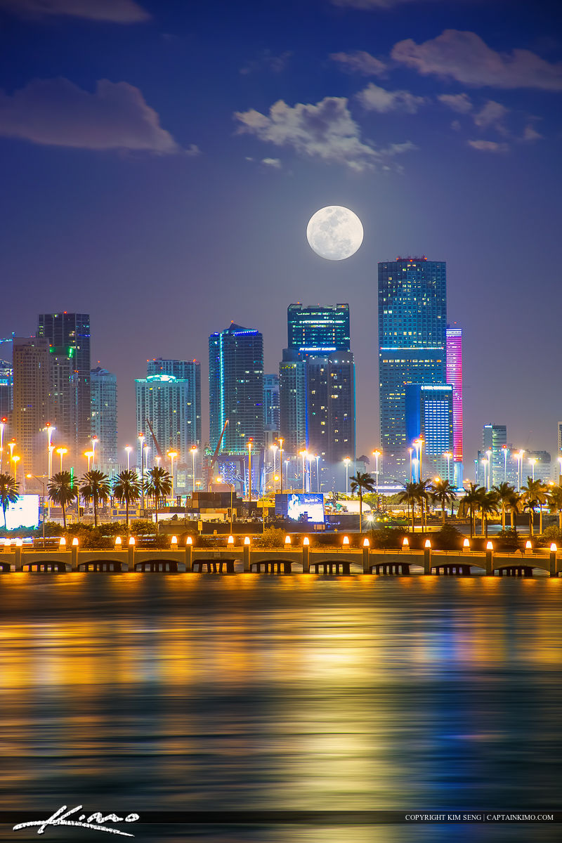 Beautiful moon setting behind the Miami Skyline buildings in Downtown Miami, Florida.