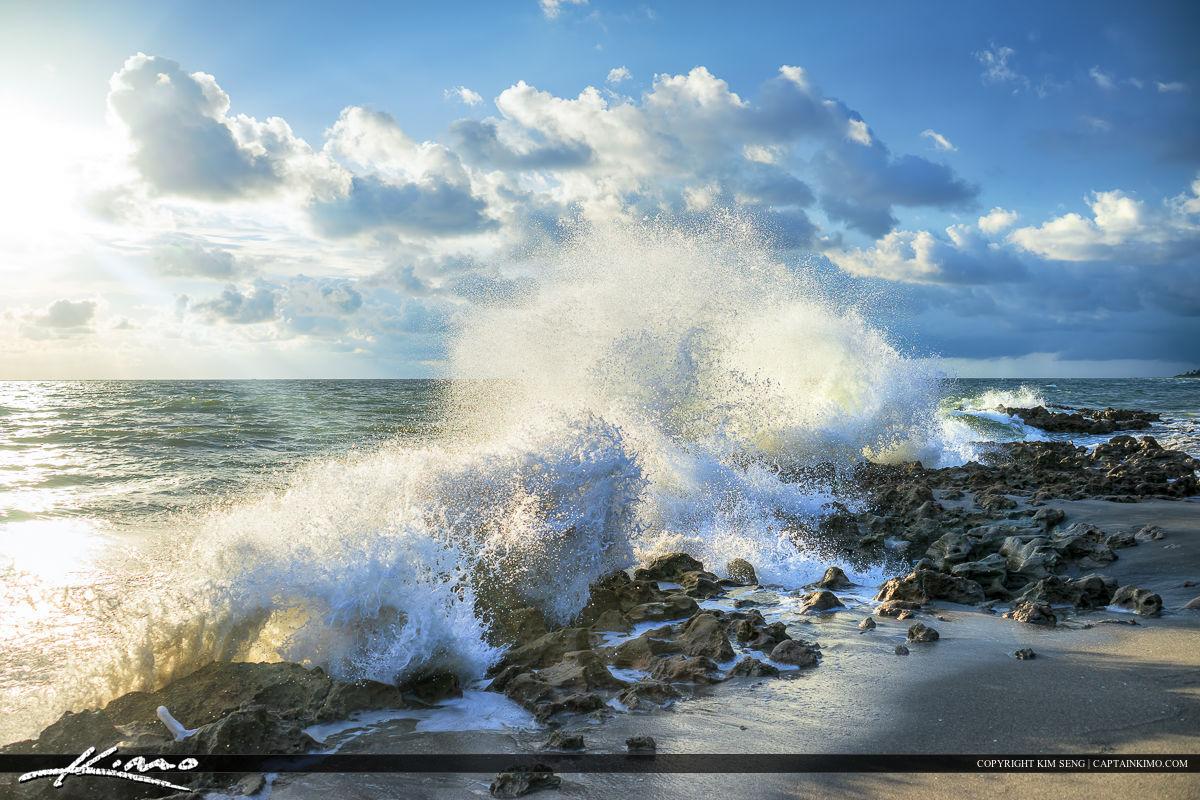 Big wave break with splash at Coral Cove Park.