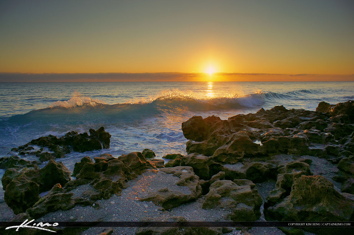 Tequesta, Florida, sunrise over Jupiter Island at Coral Cove Park with nice wave break.