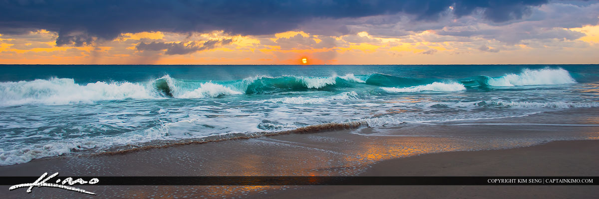 Stormy sunrise at the beach along the Atlantic Coast in Florida with wave break.