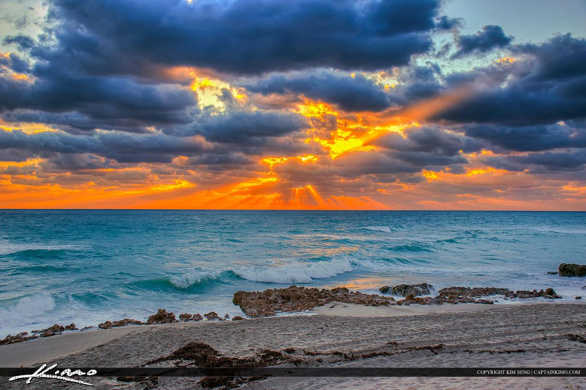 Beach Sunrise with Sunrays Through Clouds