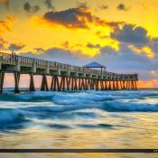 Juno Beach Pier Sunrise on a Wavy Ocean Morning