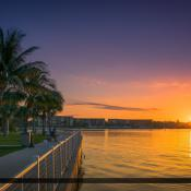 Sunrise from Sawfish Bay Park at waterway with Jupiter Inlet Lig