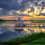 Beautiful colors and clouds along the lake in Tradition during sunset in Port St. Lucie Florida. HDR photo created in Photomatix Pro and Topaz software.