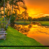 Found a great place to watch the sunset in Jupiter, Florida. This day was an amazing evening with fiery warm colors after a storm. HDR  image created in Photomatix Pro and Topaz software.