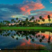 Intense colors over Palm Beach Gardens, Florida at a small lake behind the Gardens Mall. HDr image created in Photomatix Pro and Topaz software.