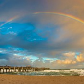 Panoramic view of the Juno Beach Pier with a beautiful rainbow over the Atlantic Ocean, Florida. HDR image tone mapped using Photomatix Pro and Topaz software.