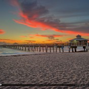 Beautiul cloud colors during sunrise at the Juno Beach Pier along the Atlantic Coast in Palm Beach County, Florida. HDR image created in EasyHDR and Topaz software.