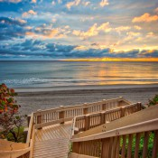 Sunrise from Red Reef Park in Boca Raton Florida with stairs going to the beach. HDR image created using Aurora HDR software.