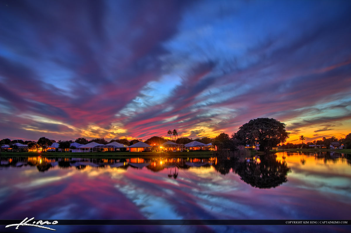 Sunset at a neighborhood in Palm Beach Gardens Florida along Lake Catherine, Palm Beach County, Florida.