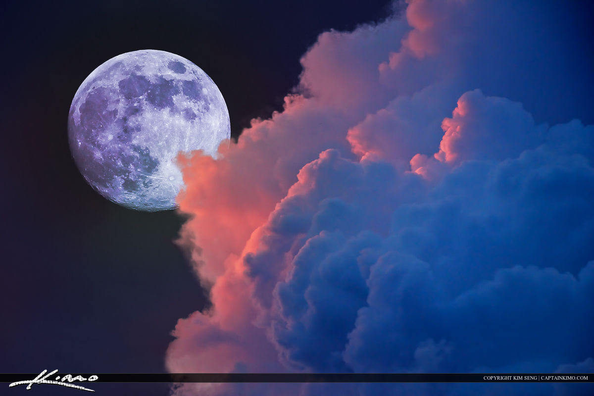 Lunar Moon Rise with Colorful Clouds in Sky