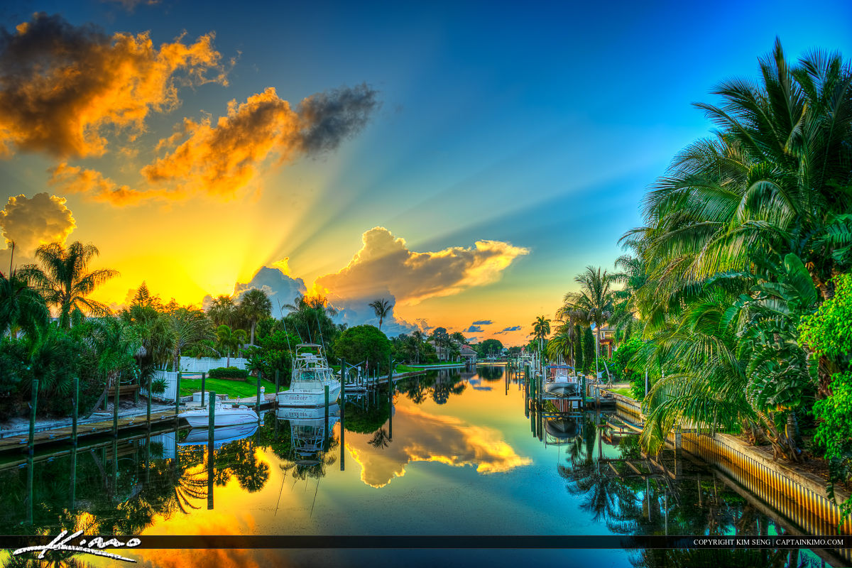 Beautiful sunrise over Cabana Colony Canal along some waterfront properties in Palm Beach Gardens during Memorial Day 2014. HDR image created in Photomatix Pro.