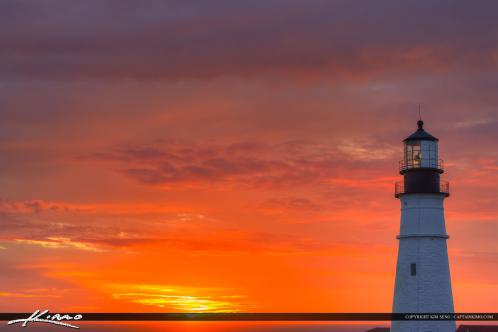 The lighthouse at Cape Elizabeth Maine in Fort Williams Park during sunrise.