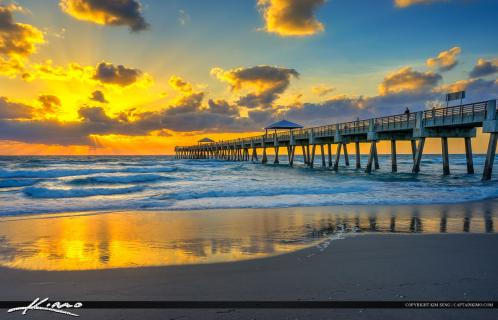 Beautiful sunrise at the Juno Beach Pier in Palm Beach County, Florida. HDR image tone mapped using Photomatix Pro and Topaz software.