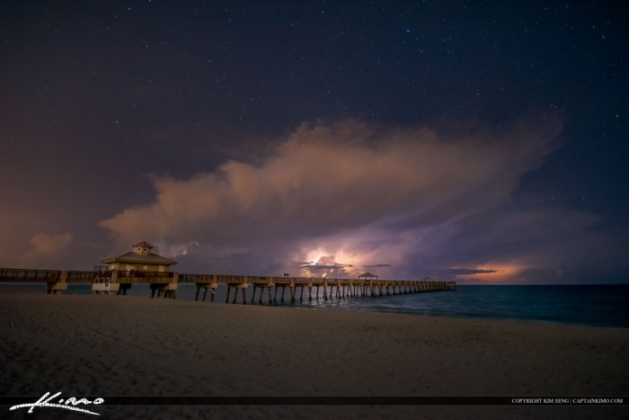 Storm Over the Juno Beach Fishing Pier at night with lightning over the Atlantic Ocean. Image tone mapped in Photomatix Pro and enhanced with Topaz software.