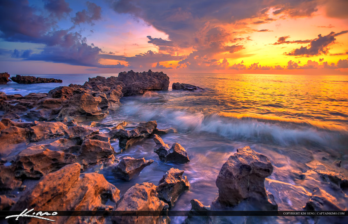Wave Breaking Over Rocks at Beach Tequesta Florida