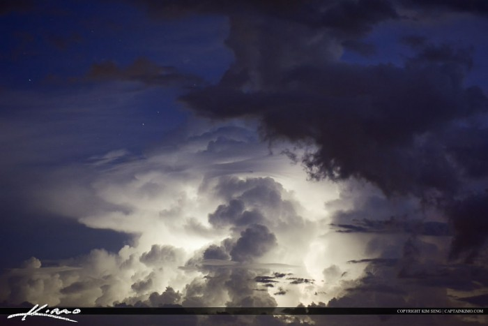 Storm Clouds Lit Up by Lightning in Sky
